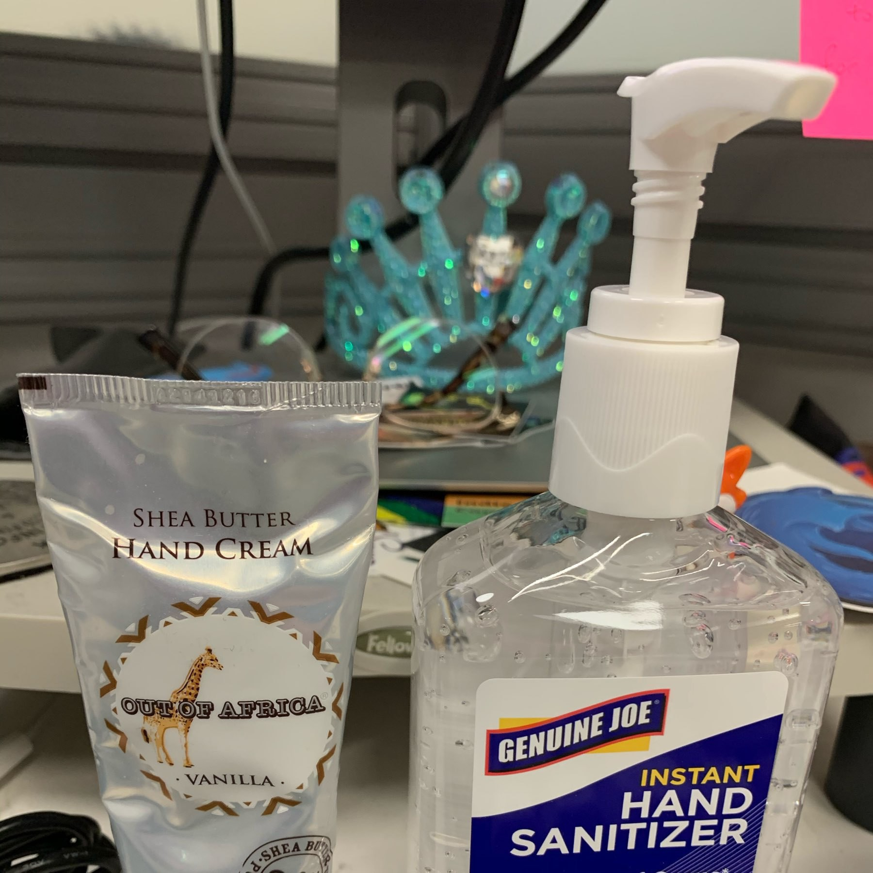 a photo of a tube of shea butter hand lotion, and a pump bottle of hand sanitizer